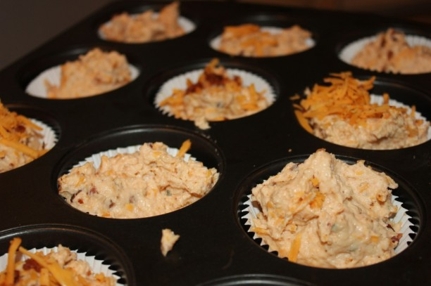 ... the bacon and cheddar so you can top the muffins before you bake them